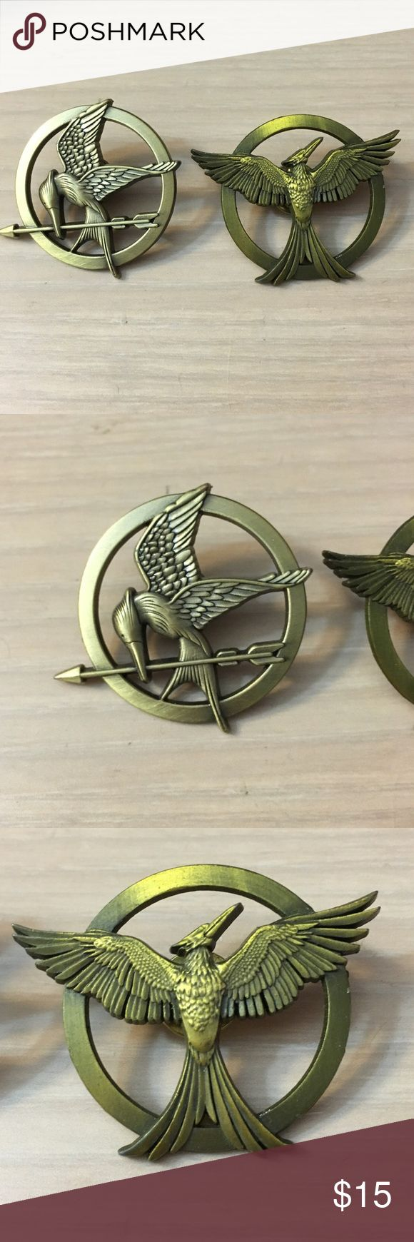 Hunger Games Pins 2 hunger games pins in PERFECT condition. Could be used for your Halloween costumes or as a collectible. These are about 5cm Jewelry Brooches