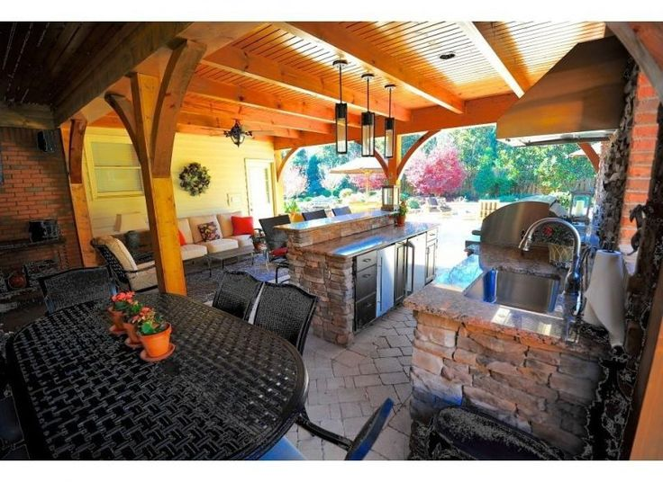 Backyard Folding Picnic Table And Bench With Flood Light Also Outdoor Bars And Portable Propane Bbq Besides Flat Top Griddle  Ceramic Briquette  Muskoka Chair  Bbq Cover  Outdoor Bistro Table  Outdoor Coffee Table     Backyard with an Outdoor Kitchen Mediterranean Style for Modern House