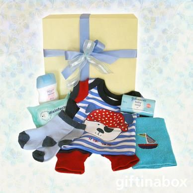 Perfect for the new baby boy arrival! A selection of baby clothes and bath products with a sailor theme. All beautifully presented in a cream box with blue ribbons and bows. All goods are lovingly presented in a cream box decorated with red ribbons and tissue paper.   Johnson's baby moisturising lotion Johnson's baby wipes Johnson's baby soap baby socks Sailor themed facecloth Sailor themed vest and leggings