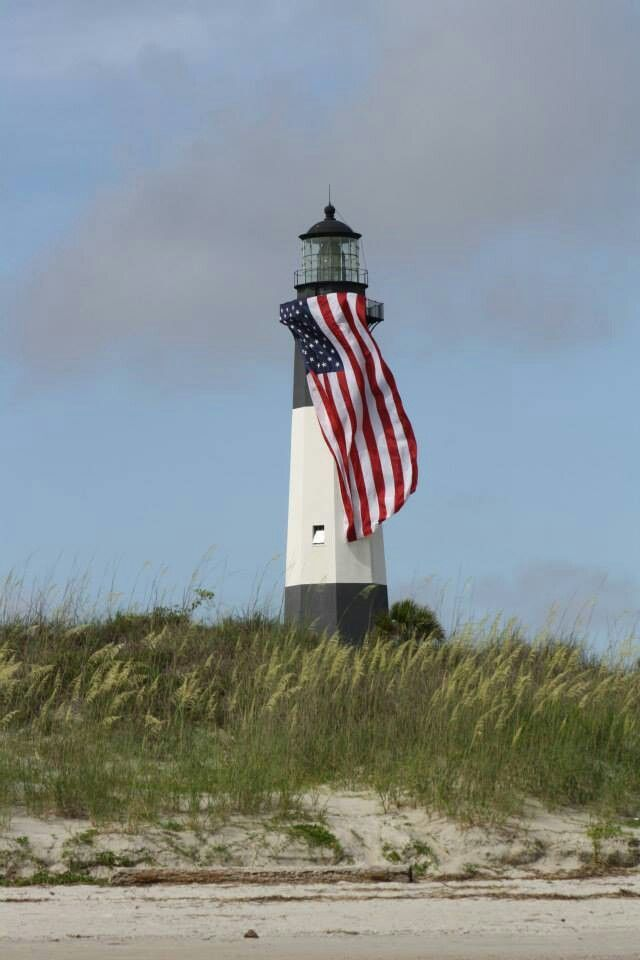 """""""American Flag Waves in Front of Lighthouse at Dawn"""" by ... 