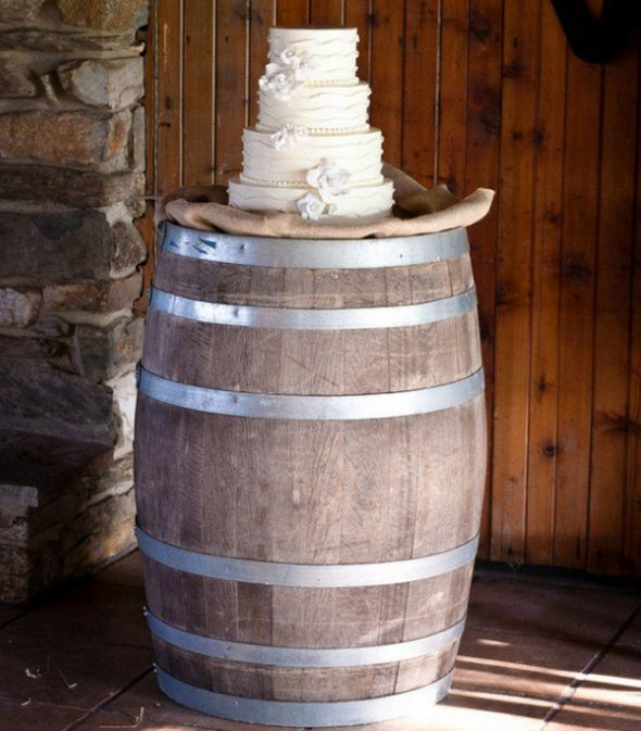 Rustic white wedding cake whiskey barrels