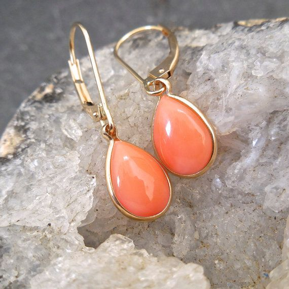 Coral Earrings - Natural Coral Earrings, Pear Coral Earrings, 10 x 7 mm, Orange, Blush, Pink, Peach Coral, Coral Dangle Earrings Casual elegance, timeless peach Coral earrings simply frame in our thin bezel. A natural, pear or tear drop shaped cabochon Coral gemstone, naturally beautiful.