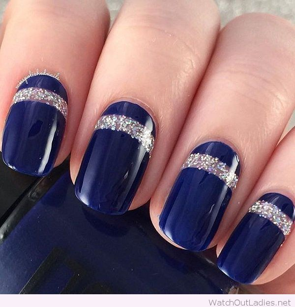 Navy nails with silver glitter details