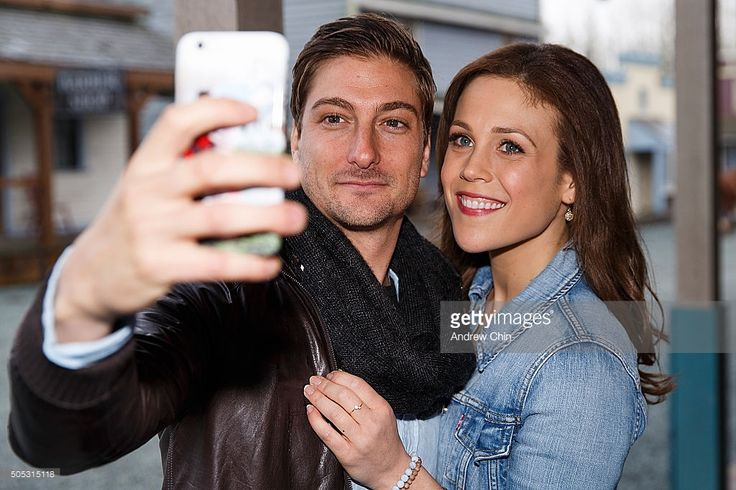 Australian actor Daniel Lissing and American actress Erin Krakow take a selfie during Hearties Family Reunion fan convention for 'When Calls The Heart' at Jamestown on January 16, 2016 in Langley, Canada.