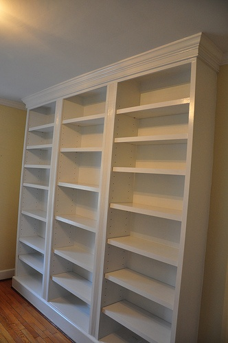 """ikea """"built in"""" book shelves trim, baseboard and crown moldings"""