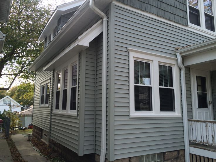 """Another photo of a finished home and garage siding project completed by Allrite Home & Remodeling specialists. The look was achieved using Mastic Quest vinyl Siding 4"""" exposure, Mastic Cedar Discovery vinyl hand split cedar shake,  Quality Edge aluminum soffit and fascia system in white."""