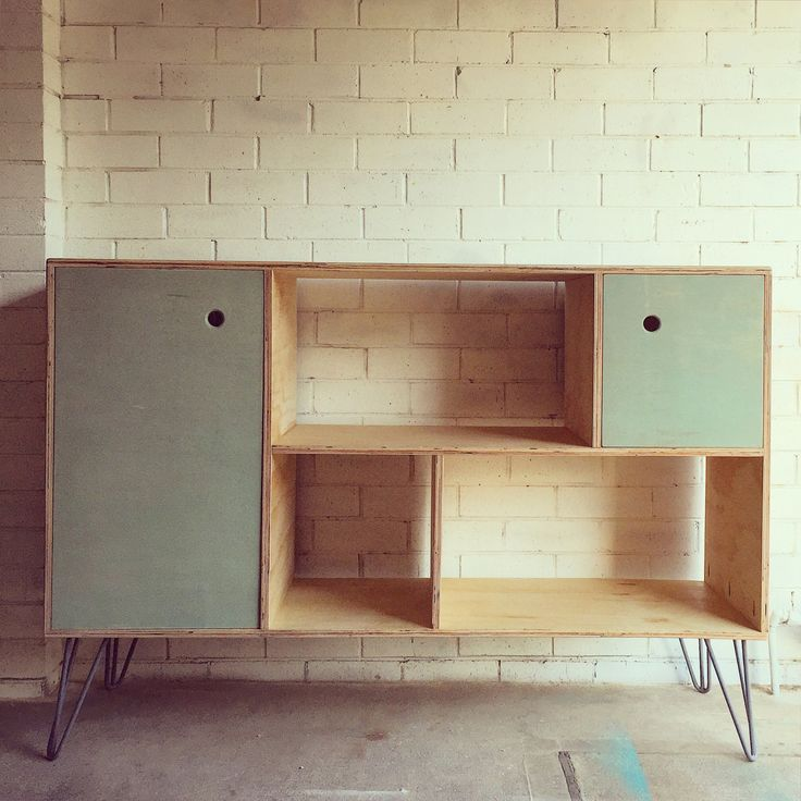 This mid-century style cabinet is an original design that suits a living room, studio, bedroom, home office or the kids playroom. • THE CABINET is 1800mm wide, 450mm deep and 1100mm high including metal castors or grey powdercoated hairpins.  • THE DOORS are finished in soft eucalyptus green, with finger holes, quality cabinet hinges and magnetised door catches for easy opening and closing. • THE BACKING is dark grey and adds dimension to the open sections.  ••• Please contact me BEFORE…