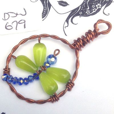 doinWire-DOW679 Pendant twisted copper circle, dragonfly green cat-eye bead wings and lilac glass bead body.