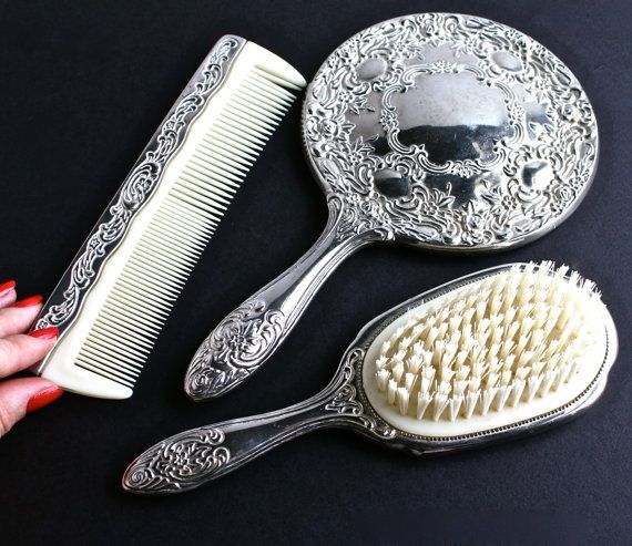 This reminds me of the Set my Grandma had (cc) Vintage Vanity Set Silver Plated Hair Brush, Comb, & Mirror by MaejeanVINTAGE, $45.00
