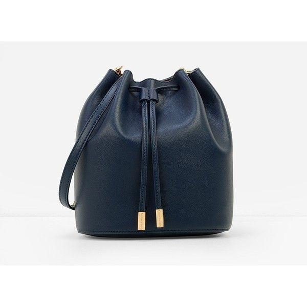 CHARLES & KEITH Drawstring Bucket Bag (275 SAR) ❤ liked on Polyvore featuring bags, handbags, shoulder bags, navy, shoulder strap handbags, navy blue handbags, sling purse, drawstring bucket bag and navy blue purse