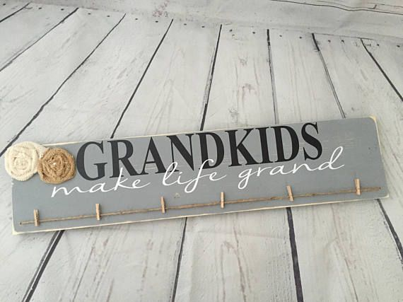 This sign measures 24 long by 5.25 tall and comes with 6 clips for pictures and/or artwork from the grandchildren. Please specify color(s) at checkout or message us with any questions. If nothing is specified it will be done in olive green as shown in the first photo. This sign comes ready to hang and is a great gift for grandma or grandpa! Sign WILL come with burlap flowers unless you specify otherwise. 6 mini clothespins are provided. Please specify if you would like it distressed! If...