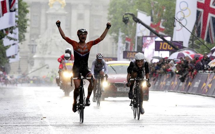 Netherland's Marianne Vos celebrates winning ahead of second-placed Lizzie Armitstead of Great Britain during the women's road race on The Mall