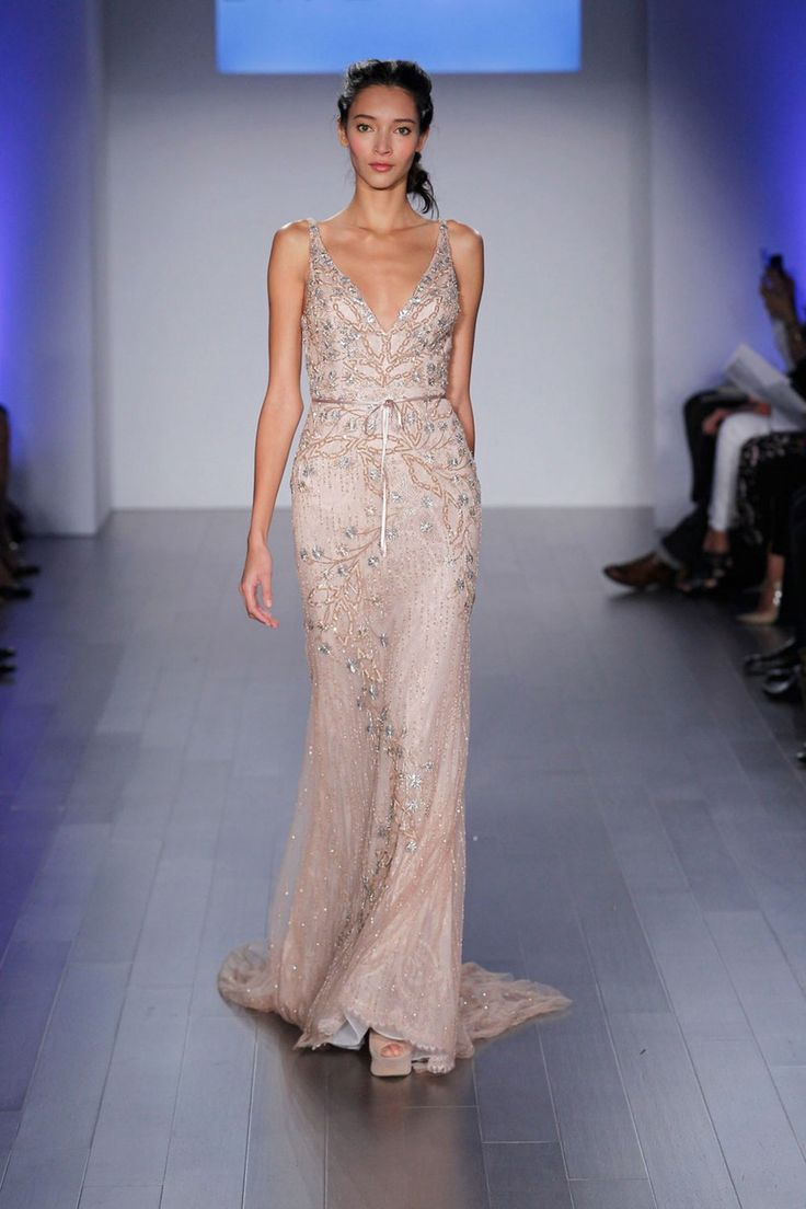 Until I looked at the season as a whole, I didn't realize how romantic the fall 2015 runways were. Wedding dresses with soft silhouettes and miles of tulle—it's like the designers were high on love. Here are 18 insanely gorgeous gowns I'm still dreaming about three months later. Wedding Dress 1: ANGEL SANCHEZ Wedding Dress 2: ANNE BARGE Wedding Dress 3: CAROLINA HERRERA Wedding Dress 4: DENNIS BASSO Wedding Dress 5: ELIZABETH FILLMORE Wedding Dress 6: HOUGHTON BRIDE Wedding Dress 7: INBAL…