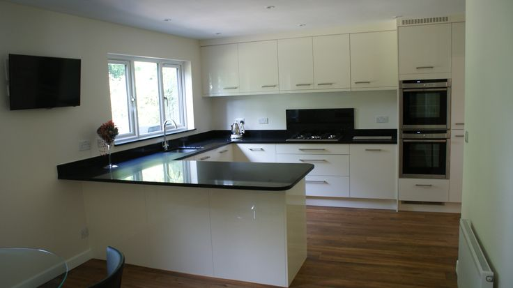 Modern Gloss White Kitchen In Ascot Berkshire With Karndean Flooring And Black Granite Work Tops