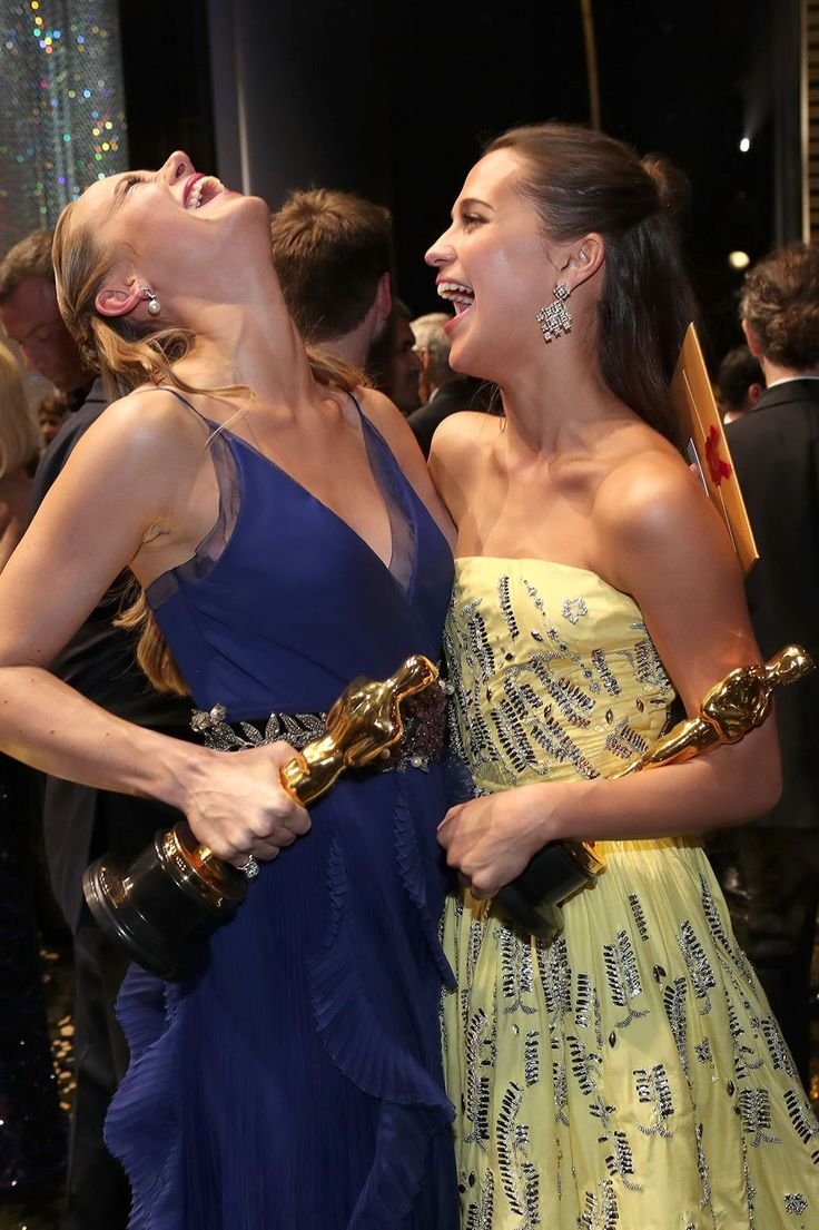 2016 winners Brie Larson and Alicia Vikander throw their heads back in laughter at the end of the Oscars.