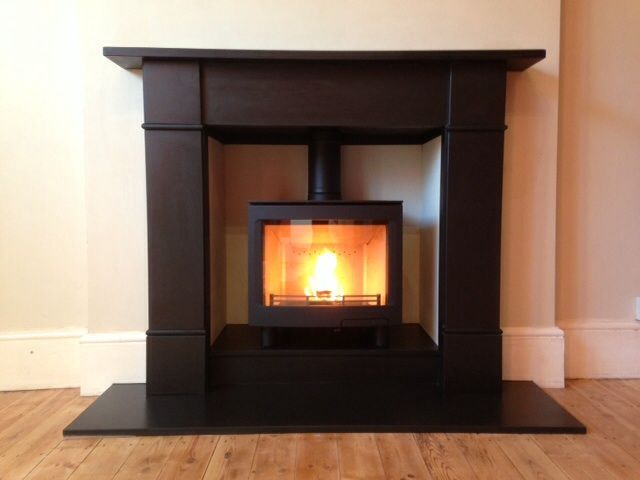 Here's a Contura i5L Panoramic wood burning stove in black with a slate stone fireplace made by Worcestershire Marble. This work was carried out by our HETAS installers in Kings Norton, Bham