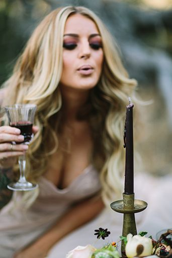 Spellbound Halloween Wedding Bride with Dark Candle, Moody, spellbound wedding, dark and mysterious wedding, blowing out candle, burgundy candle decor, cocktail bar decor