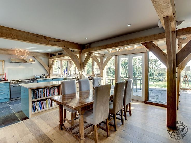 Kitchen and Dining Room Interior with Exposed Oak Frame by Carpenter Oak Ltd