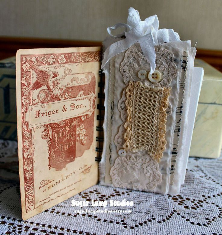 I am sharing this little Baby Cabinet Card Journal that I made. It has old laces, watercolor paper, sari and seam binding ribbon, vintage sheet music, and chipboard tags. It has a ring binding as well. They are tedious to make, but very fun! Trying to stay busy creating in the studio and