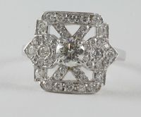 An 18ct white gold Art Deco style dress ring with saltire and set diamond to the centre SOLD FOR £1200
