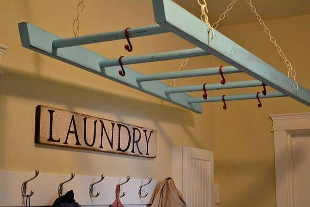 Use a hanging ladder in the laundry room as a drying rack