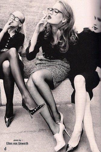 by ellen von unwerth, black and white photo, 3 beautiful girls, glasses, heels, skirts