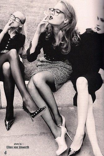 by ellen von unwerth, black and white photo, 3 beautiful girls, glasses, heels, skirts