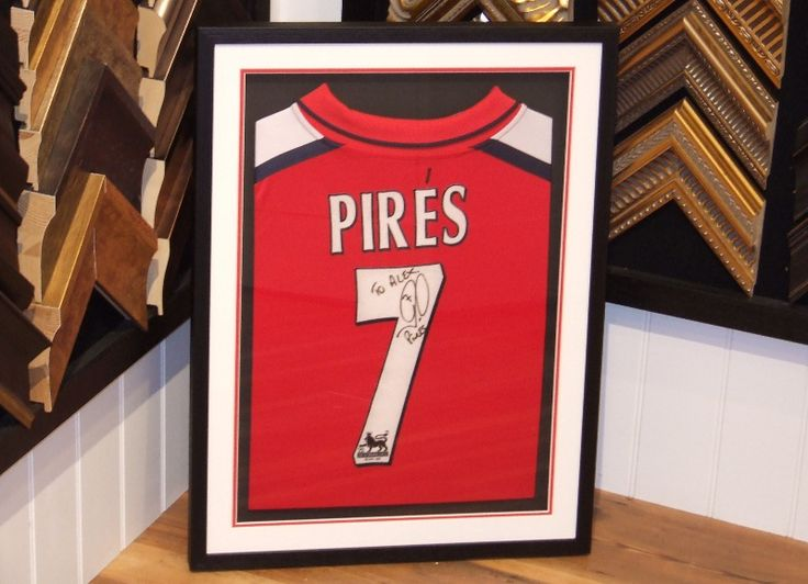 Classic black, white and red framing and mounting on this Pires shirt.