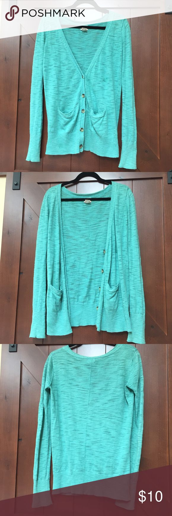 Turquoise Cardigan Turquoise Cardigan from Target.  Long and comfortable.  Has pockets and buttons.  Great condition, 100% cotton.  Size small.  Accepting reasonable offers 💕 Mossimo Supply Co. Sweaters Cardigans