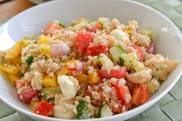 This quinoa salad recipe consists of colorful vegetables and bocconcini tossed in balsamic vinegar, extra virgin oil, Dijon mustard, oregano and garlic.