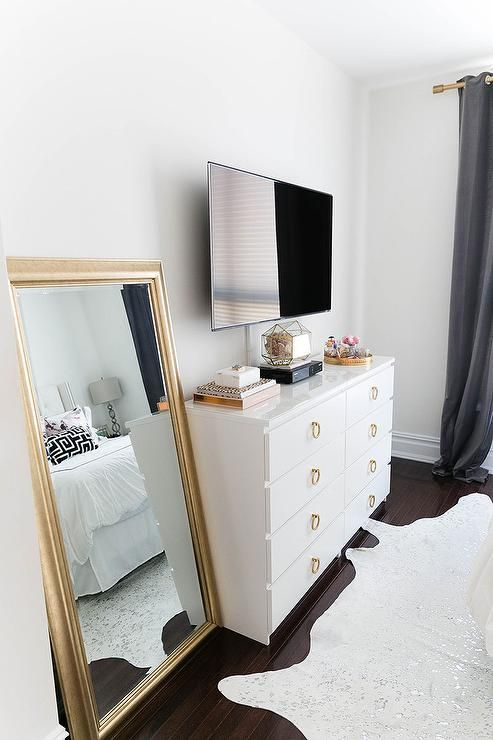 chic bedroom features a flatscreen tv atop a white ikea malm dresser adorned with gold ring - Ikea Bedroom Ideas