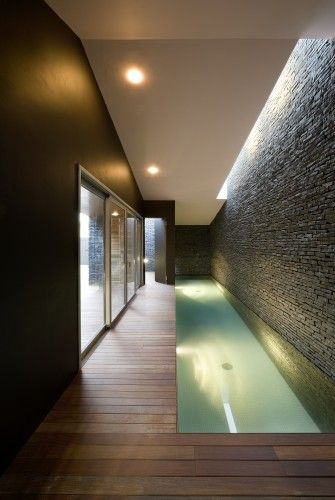 Ca'Paco / Equipo Olivares Arquitectos - we love this indoor slim design swimming pool with dark wood flooring...x