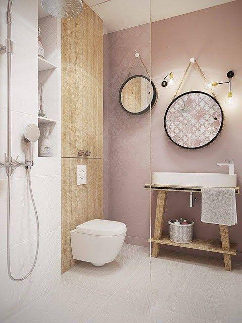 Modern bathroom inspiratie: blush pink muur met ronde spiegels en houten contrast muur. // via bycocoon.com