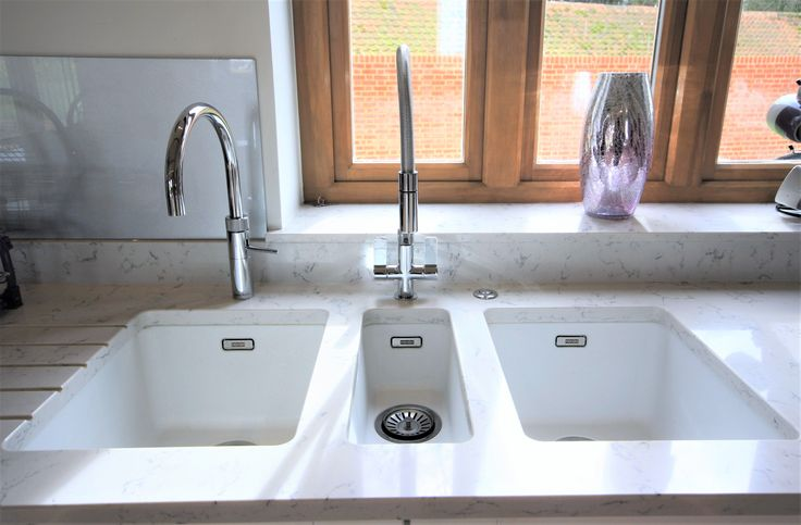 Franke Ceramic sinks in White, two bowls and a centred smaller bowl. Left hand bowl uses the instant boiling water, the small bowl uses the standard mixer tap and the right bowl has an inskinerator.