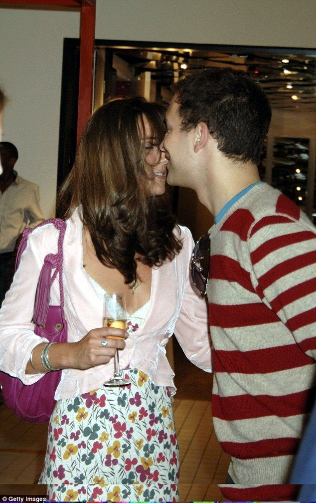 Flirty: Kate Middleton and Lord Frederick Windsor look cozy as they attend a shop opening in 2006
