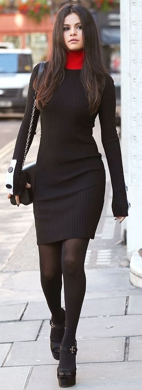 Selena Gomez in a black sweater dress, tights, and booties