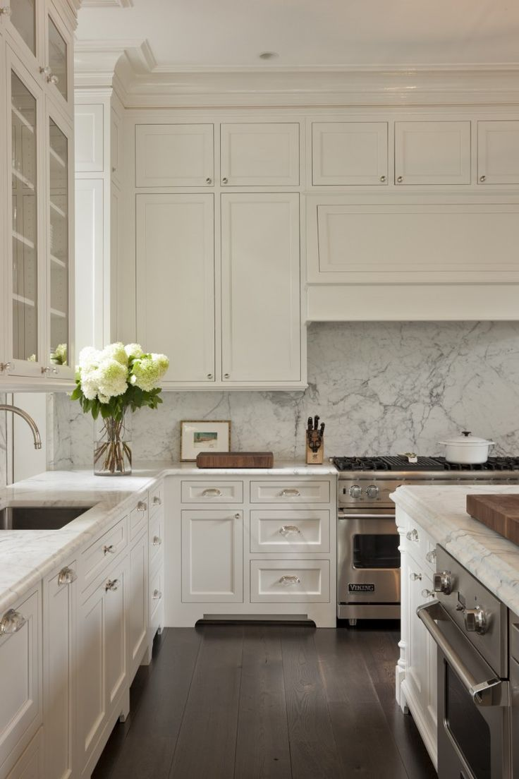 Ceiling height cabinets, marble counters and backsplash, wood floors...