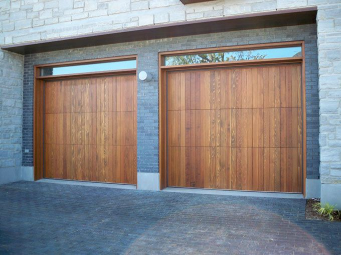 Modern, zen, contemporary style wood garage door in red cedar with vertical V-joint and clear glass transom.