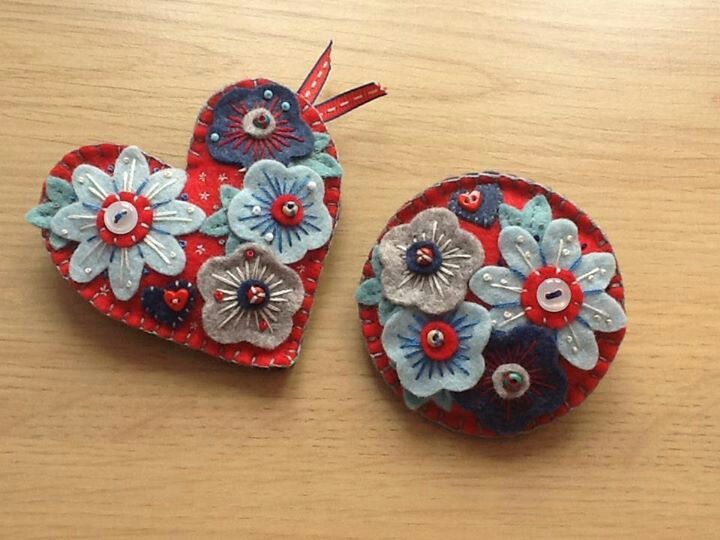 Red and blue floral brooches, handmade in felt with bead and button embellishments.