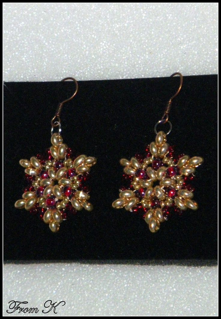 "#Star pattern bead woven #holiday #earrings. Sophisticated color combo of gold and rose red. Made with Czech glass beads and special ""twin"" beads. (""twin"" bead is the latest trend in beaded jewelry). About 4,5cm long 15.00 Ron  For more photos, prices and other info, please visit my facebook page https://www.facebook.com/BeadsFromK/photos/"