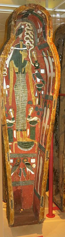 The priest of Ankh-ef-en-Khonsu. Since he is one with Osiris, he is shown (on the right, the topmost lid) with a curved beard and holding an ankh sign, the sign of life.   Wood, Luxor, New Kingdom, 1000-950 BC.