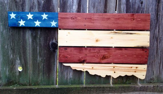 This jigsawed Oklahoma is handmade out of upcycled pallets. The unique upcycled pallet boards are stained deep red, blue, and natural with hand