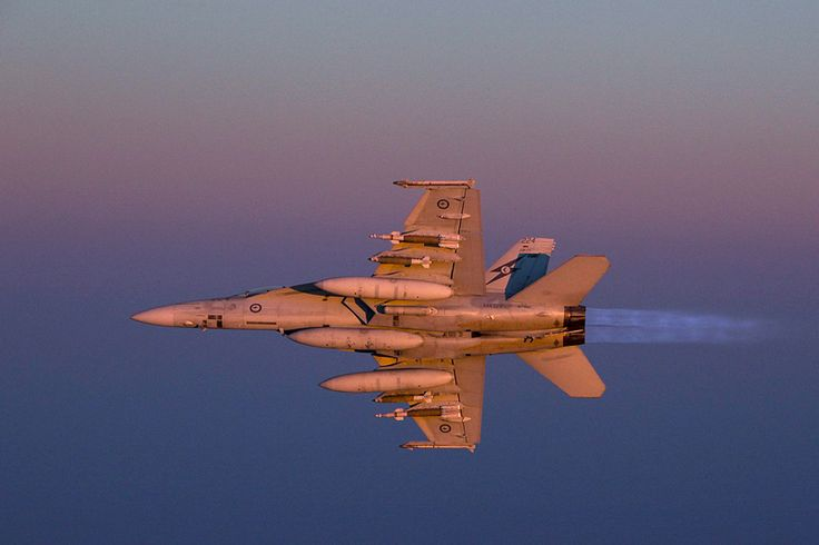 A Royal Australian Air Force F/A-18F Super Hornet ignites its afterburners at dusk over Iraq.Australia's Air Task Group (ATG) consisting of six Royal Australian Air Force (RAAF) F/A-18F Super Hornets, an E-7A Wedgetail Airborne Early Warning and Control aircraft and a KC-30A Multi-Role Tanker Transport aircraft continue to support Operation OKRA with missions in Iraq. ATG comprises nearly 400 RAAF personnel who have deployed to the Middle East.