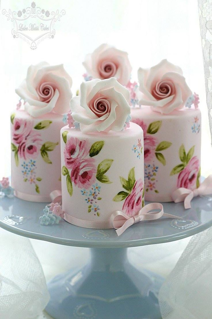 Mini cakes stenciled and painted with roses.