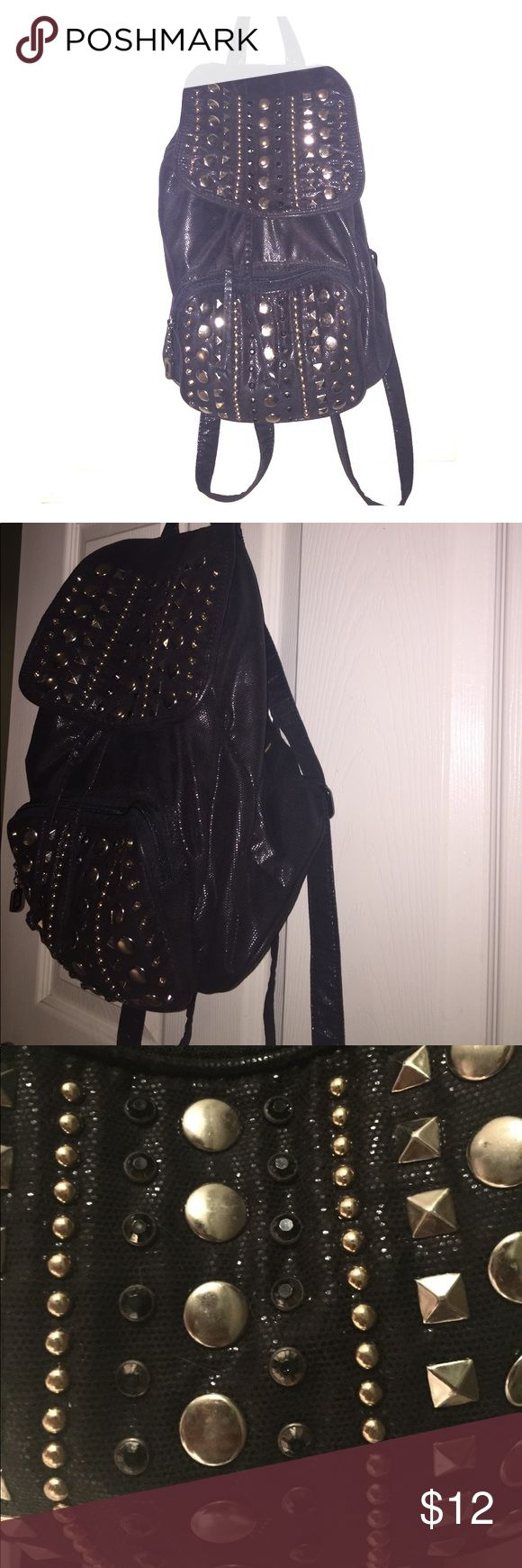 Black Studded Backpack Gently used black studded backpack. Metallic/black color. Studs have scuffs from use but bag has lots of life left. Small/Medium sized. Material: Cloth. Bags Backpacks