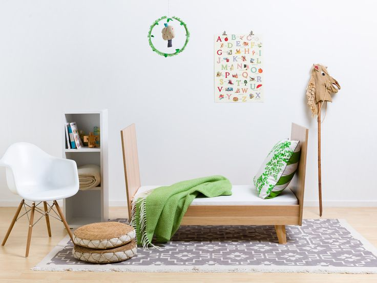 Beautiful child's room featuring Behome Alva Rug with FohFum Uno crib