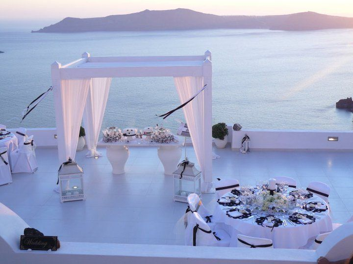Under £5,500 for 35 people. This wedding itinerary is one of the best in Greece! Your wedding ceremony will take place at one of the most wonderful private terraces in Santorini, Dana Villas, with dramatic views of the caldera and Skaros rock. A trio of traditional musicians will serenade you to the wedding location playing local wedding songs.