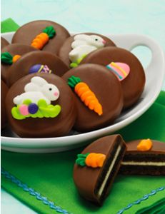 Oreos dipped in chocolate or shite chocolate and put a premade Easter cake design with frosting