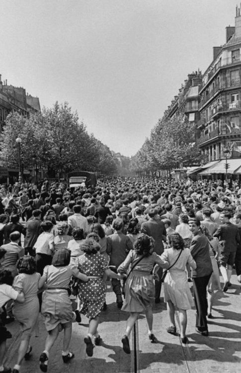 Parisians run in the streets to celebrate the end of the war in Europe 1945. Ralph Morse | LIFE | crowds | France | 1940's | WW2 | wartime | WWII | celebration | Paris | vintage black & white photography
