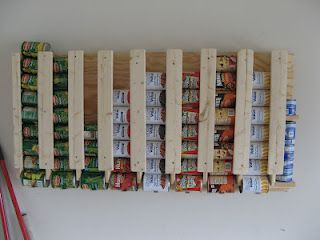 Canned food storage flush with the wall - takes very little space.  This would be good under our stairs.
